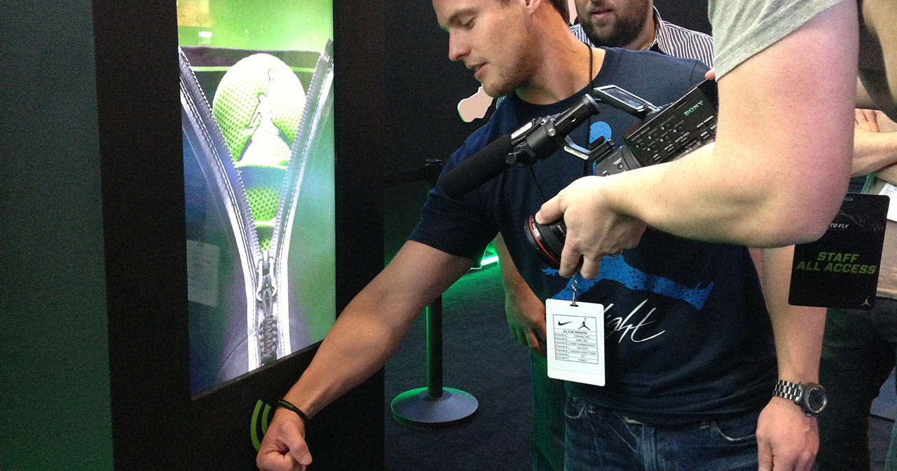 Man scans wristband at kiosk